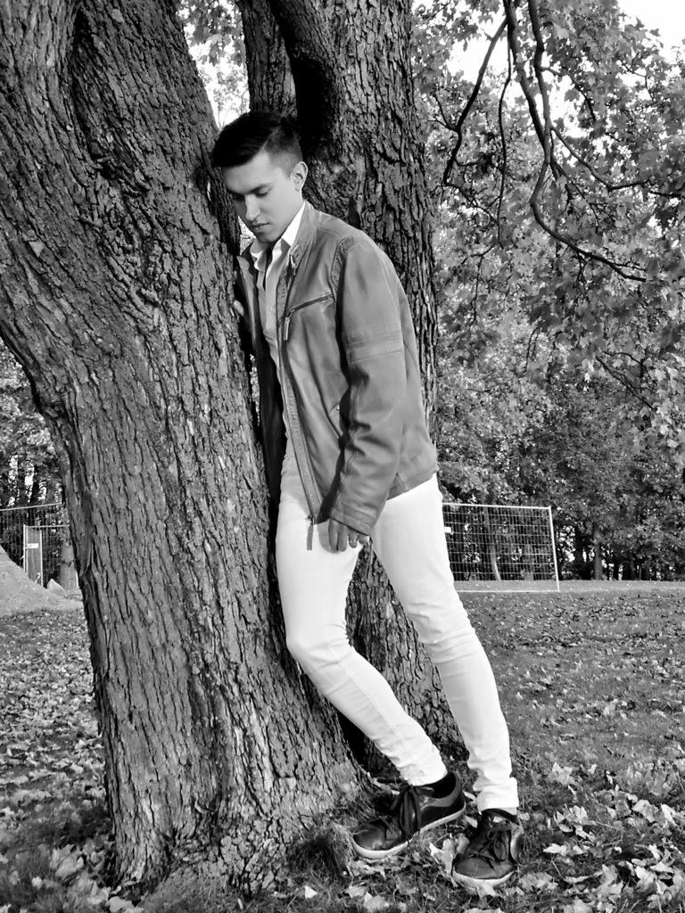 Pavel Vondracek leaning on a tree